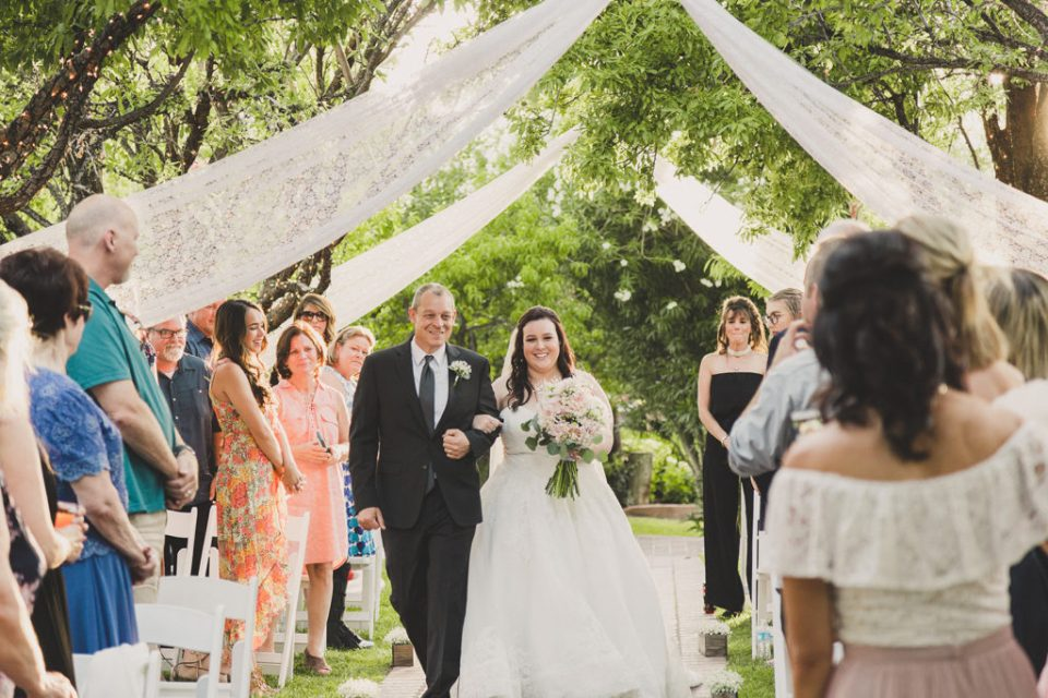 bride walks down aisle with father photographed by Taylor Made Photography