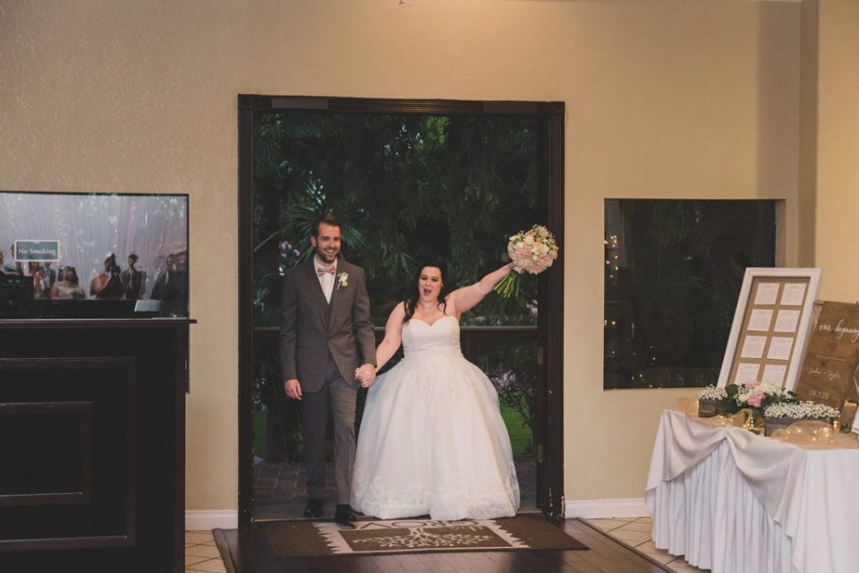 bride and groom enter wedding reception photographed by Taylor Made Photography