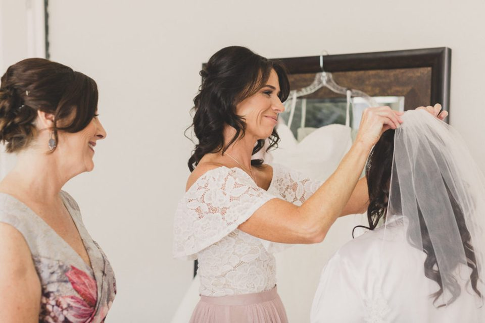 mother places bride's veil on photographed by Taylor Made Photography