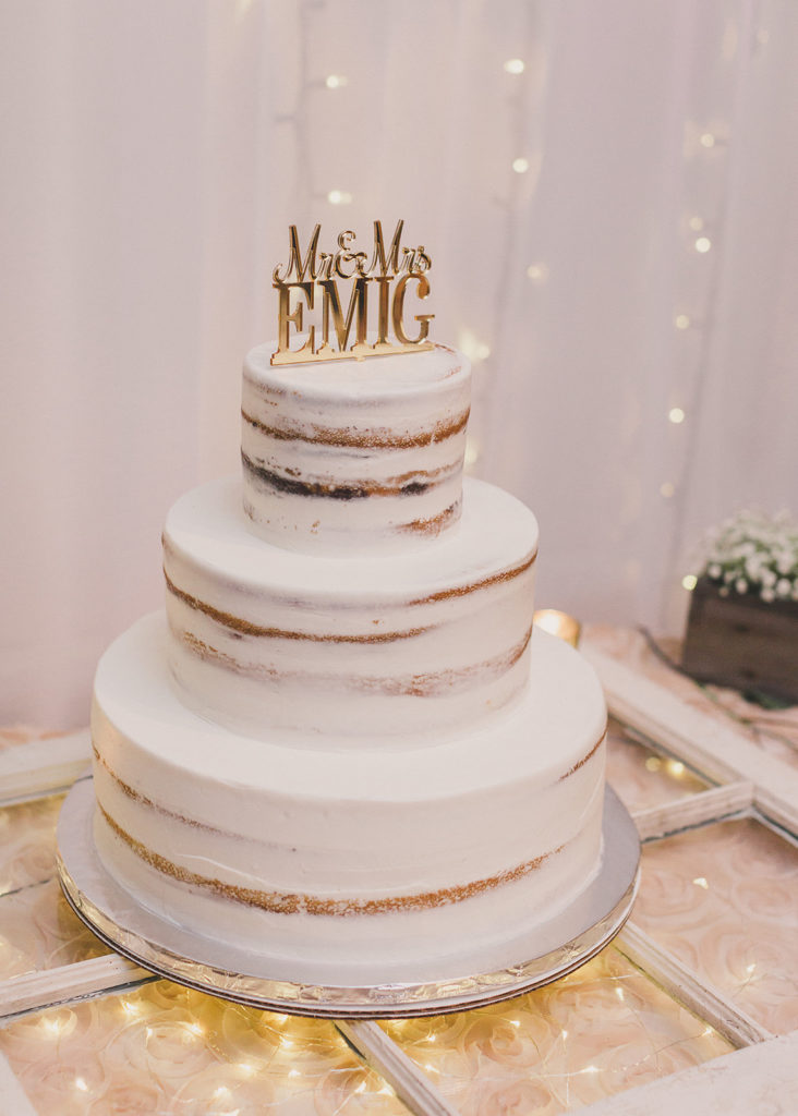 tiered naked wedding cake with gold topper photographed by Taylor Made Photography