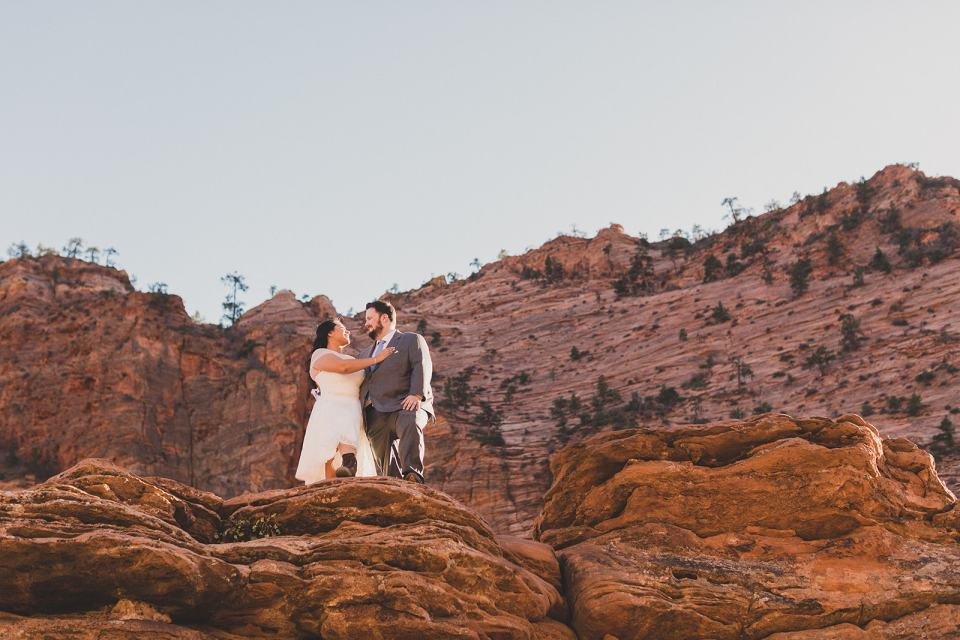 Taylor Made Photography photographs bride and groom in the red rocks at Zion National Park