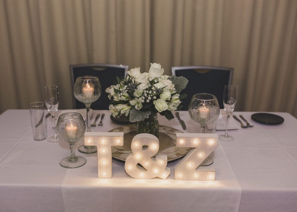 sweetheart table with marquee lights T and Z