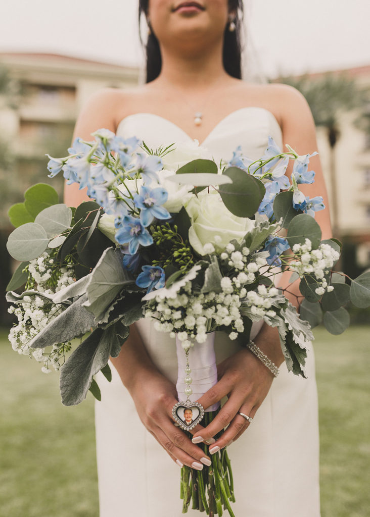 blue and white bouquet with baby's breath and charm