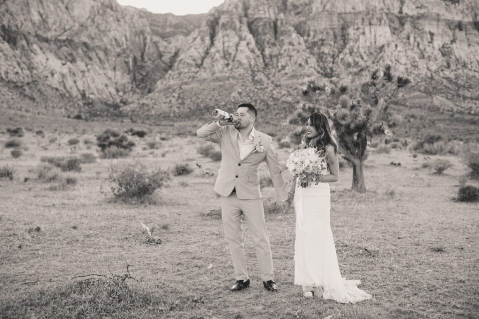 groom drinks out of champagne bottle during Las Vegas elopement with Taylor Made Photography