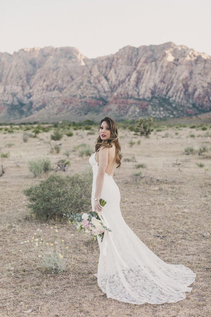 Taylor Made Photography photographs bride with wedding dress train behind her