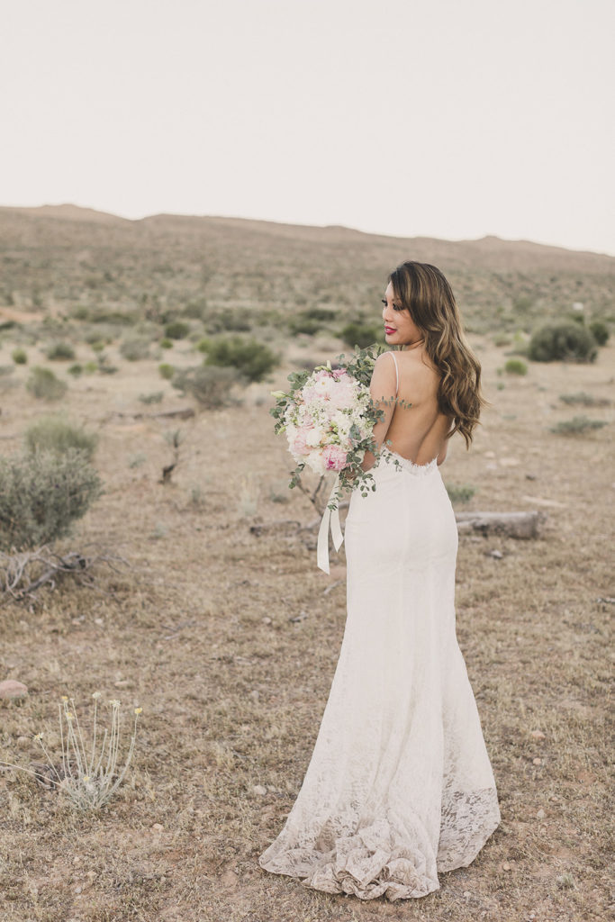 bride shoes off backless wedding gown