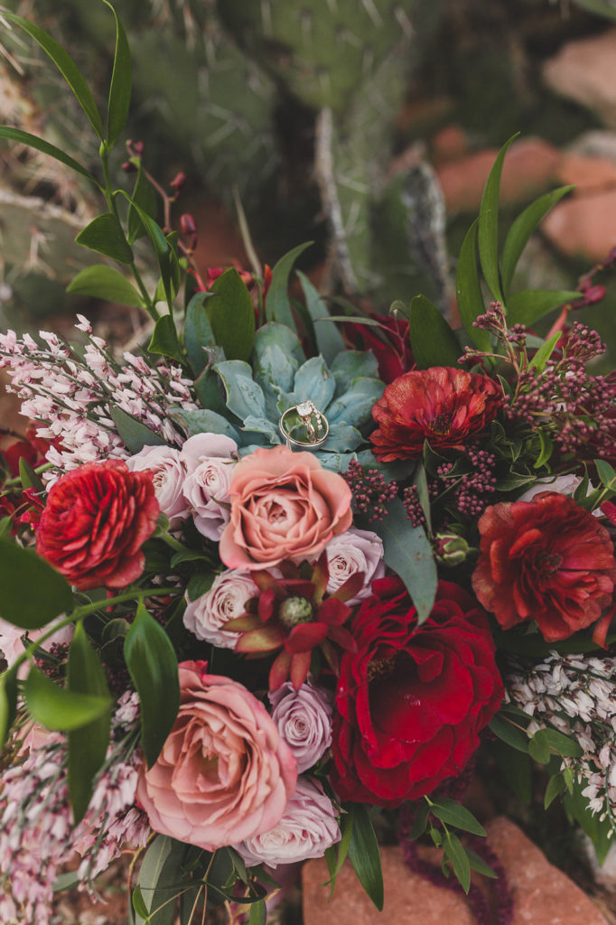 Taylor Made Photography photographs bride's ring on flowers