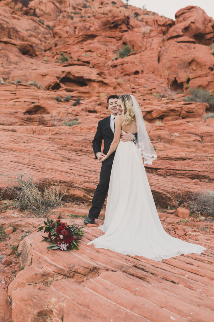 newlyweds laugh during portraits in Las Vegas