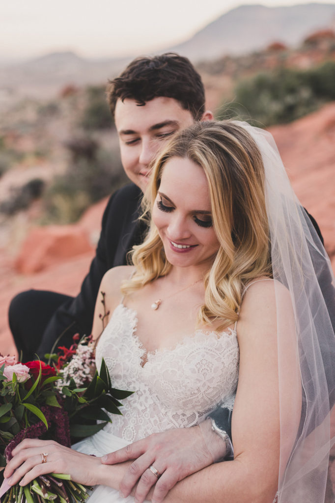 bride and groom laugh during wedding portraits in Las Vegas by Taylor Made Photography