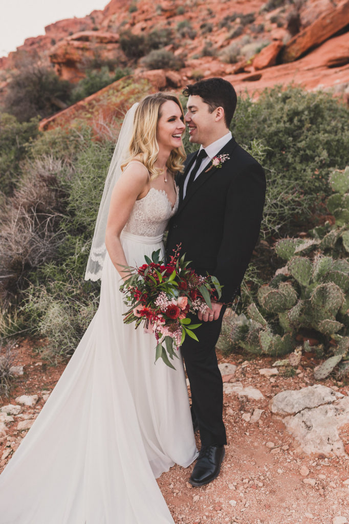 Taylor Made Photography photographs bride and groom laughing in Red Rock Canyon