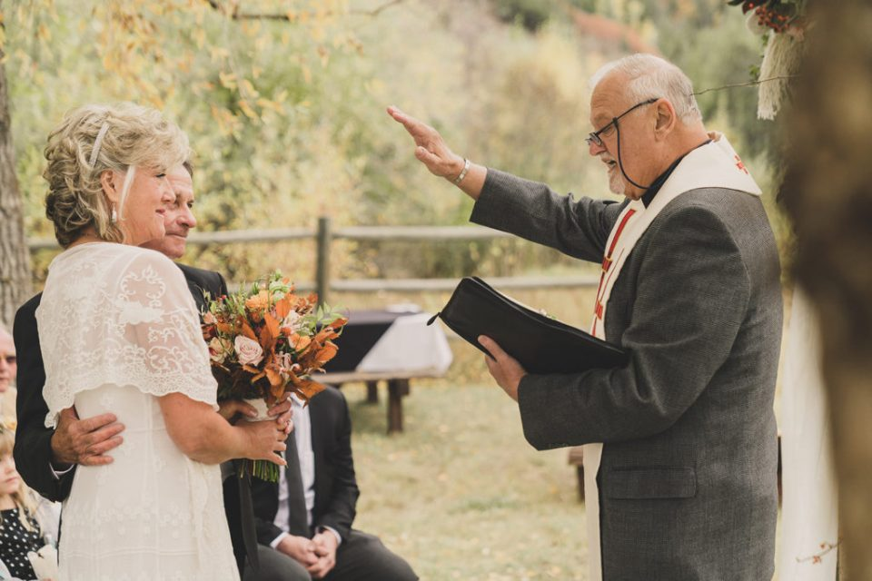 priest blesses newlyweds