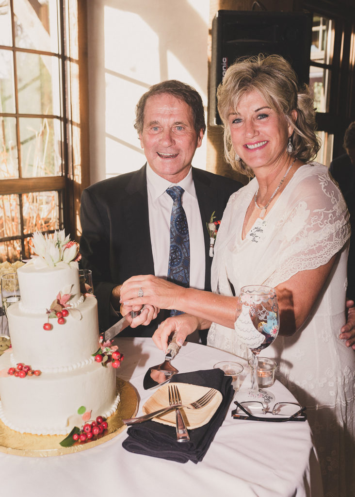 bride and groom cut wedding cake at Freestone Lodge