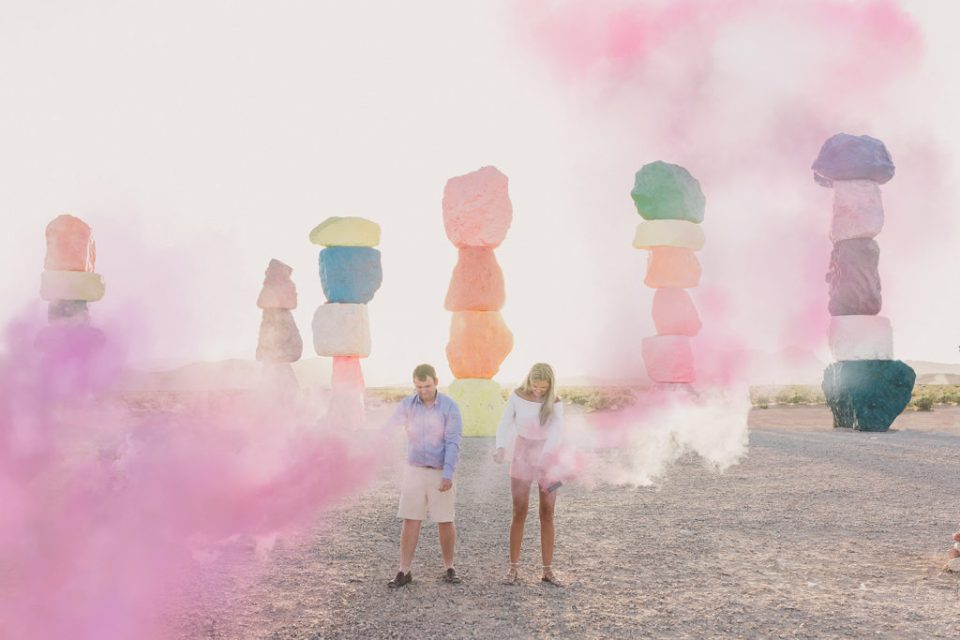 smoke bomb gender reveal for baby girl at Seven Magic Mountains