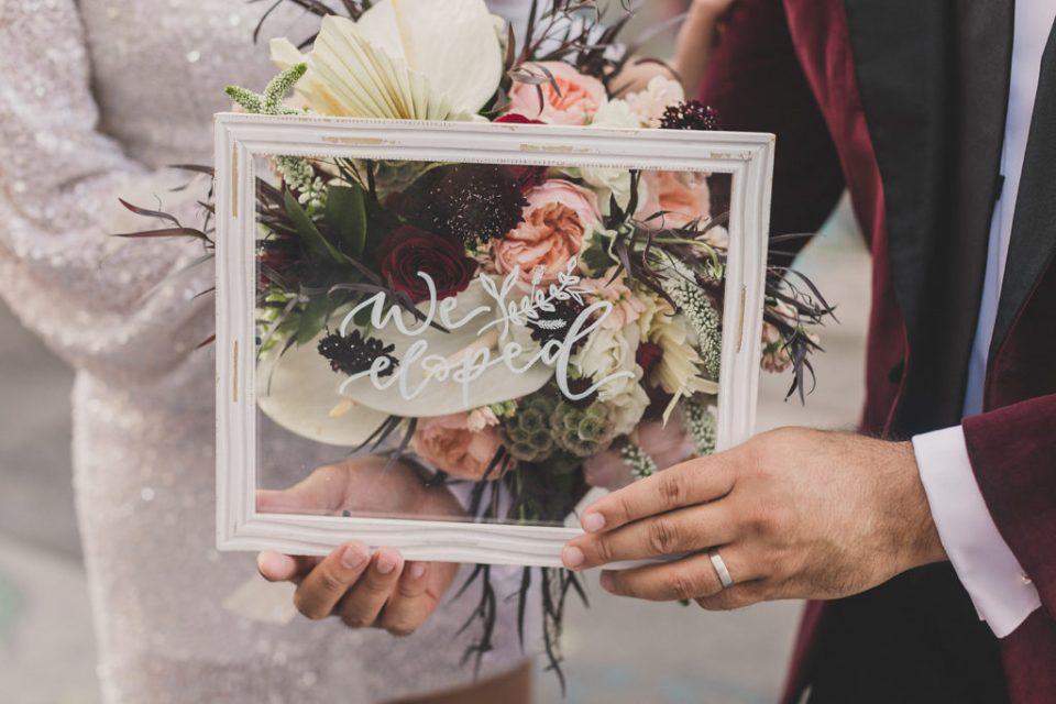 acrylic paint glass sign celebrating elopement