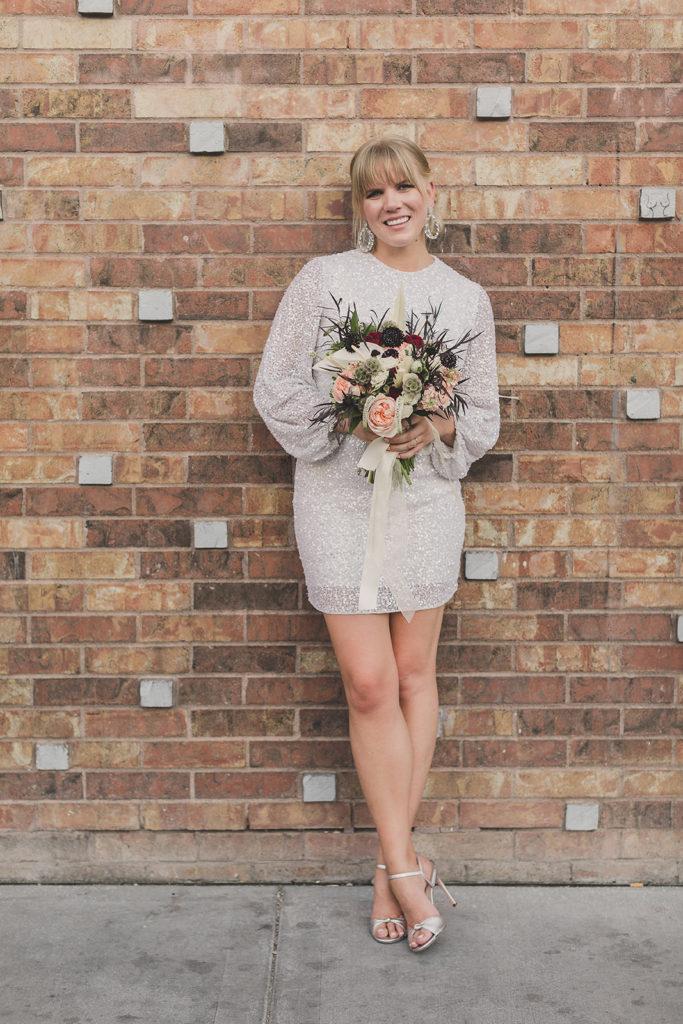 bride holds bouquet before Las Vegas elopement