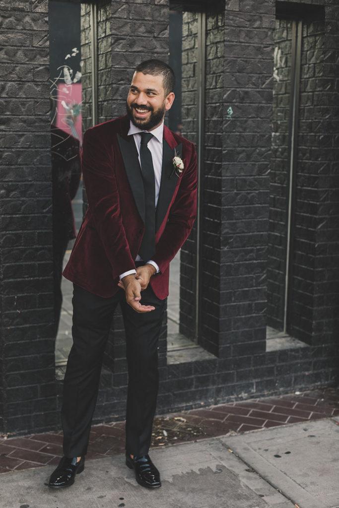 groom laughs during portraits in Las Vegas