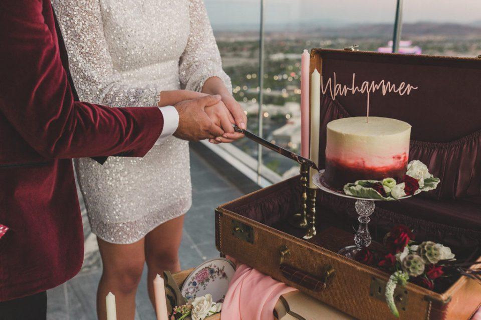 bride and groom cut cake at Red Rock Resort