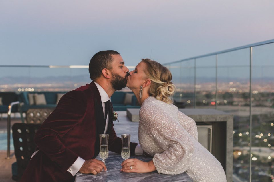 bride and groom kiss after champagne toast