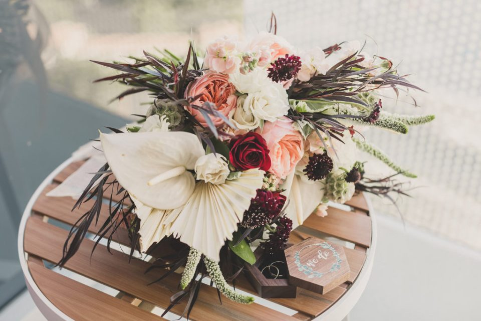 ivory bouquet with pink and red flowers  by Flourish NV