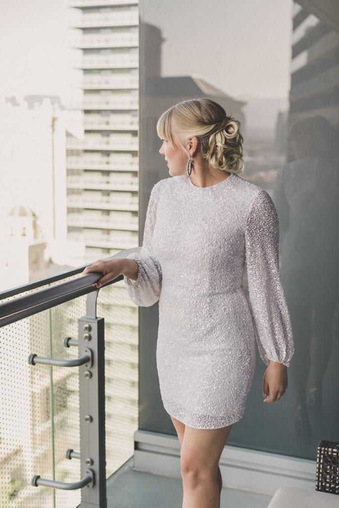 bride overlooks Las Vegas from Red Rock Resort before elopement