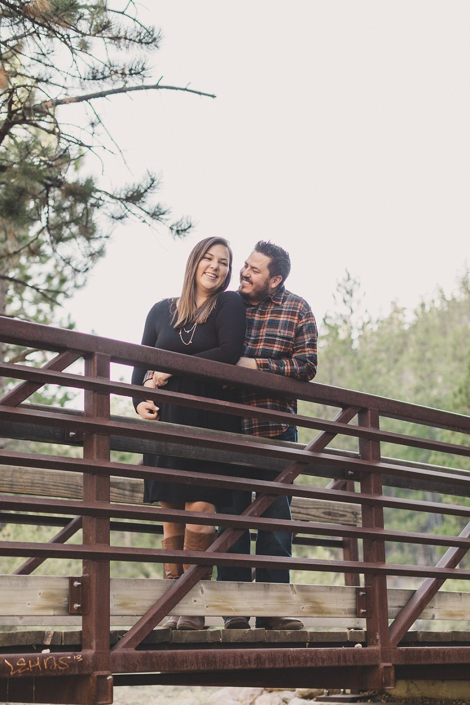 mom and dad pose on bridge during Nevada family photos
