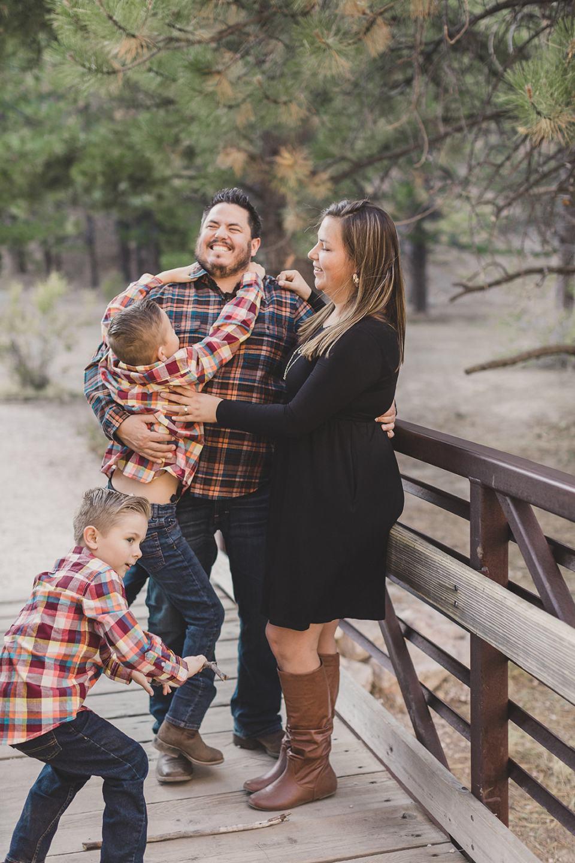 boys tackle parents during Las Vegas Family Portraits
