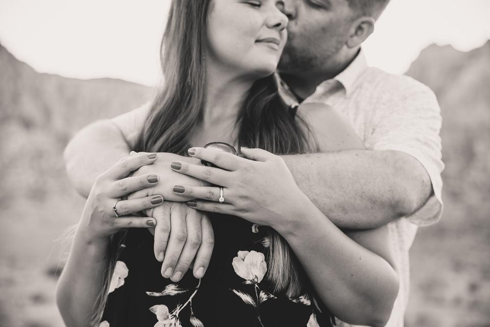 groom hugs bride after proposing in Las Vegas