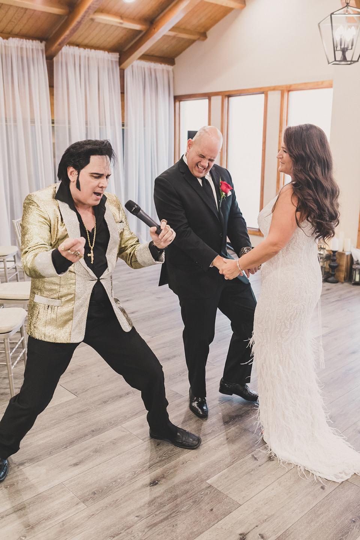 bride and groom dance with Elvis after Little Vegas Chapel Elopement