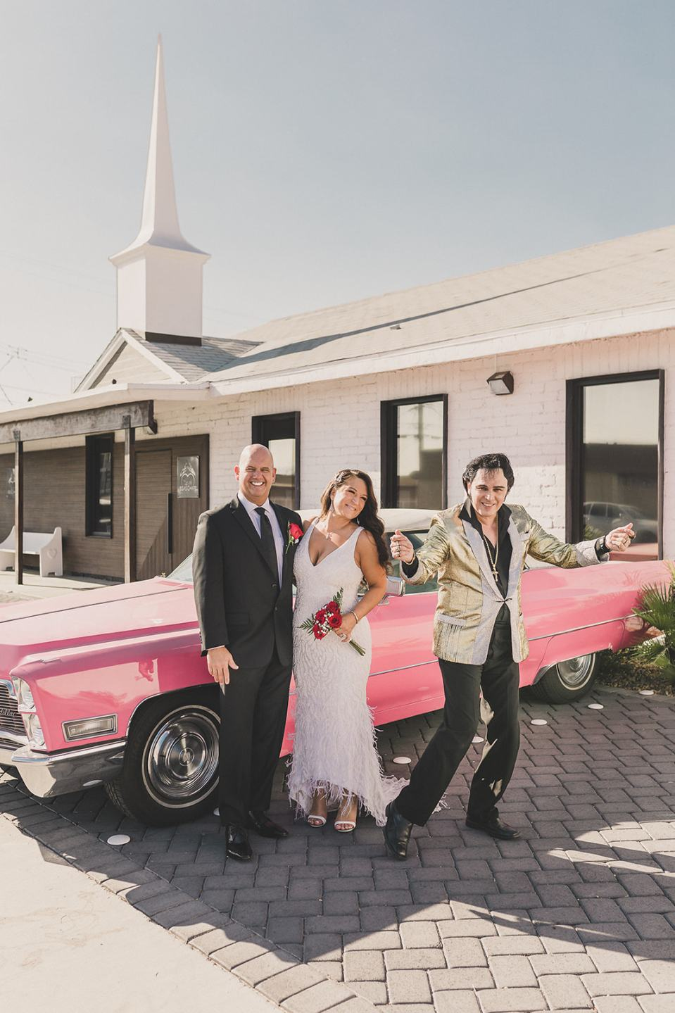 newlyweds pose with Elvis outside Little Vegas Chapel
