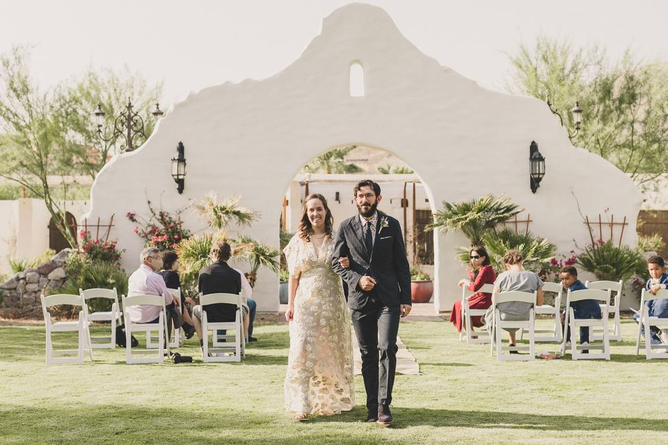 newlyweds walk up aisle after Death Valley elopement