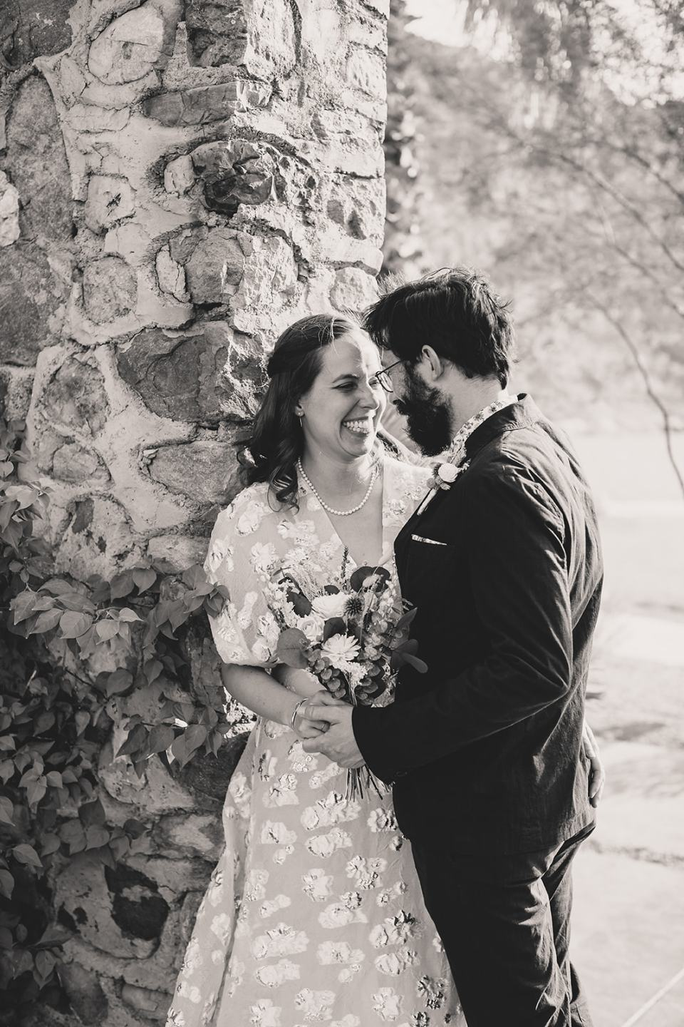 groom leans against bride during portraits after Death Valley elopement