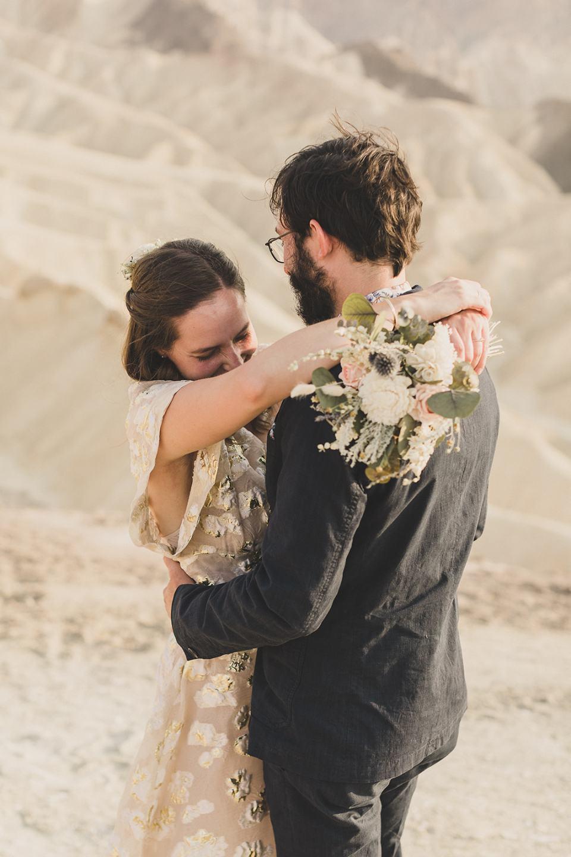 bride laughs during wedding photos at Zabriskie Point