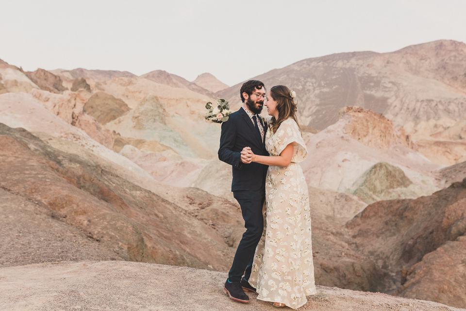 bride and groom dance together at Zabriskie Point