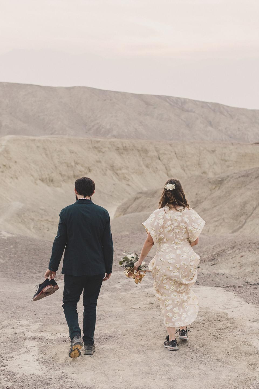 bride and groom walk through Artist Palette