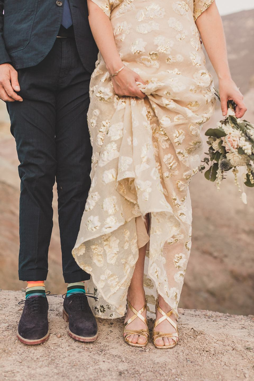 bride and groom show off fun shoes and socks at Zabriskie Point