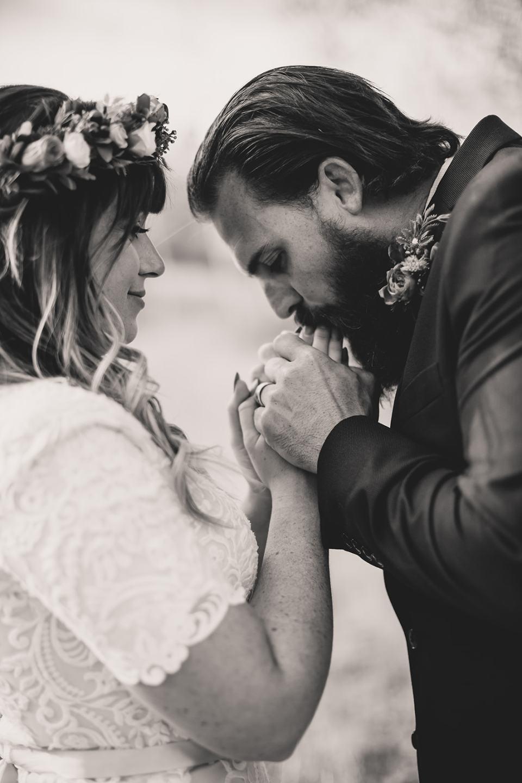 groom kisses bride's hands during Park City elopement photos