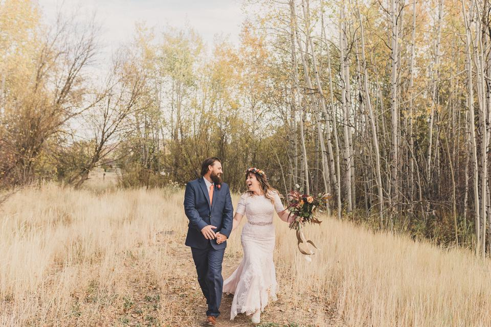 bride and groom walk on farm after Park City elopement