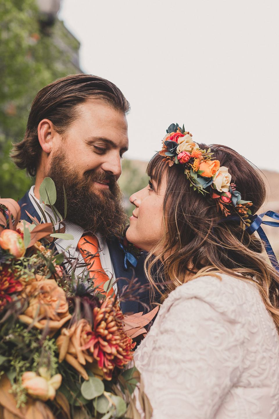 bride and groom look at each other during Park City elopement photos