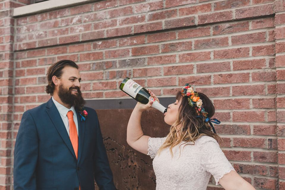 bride drinks champagne after Park City elopement