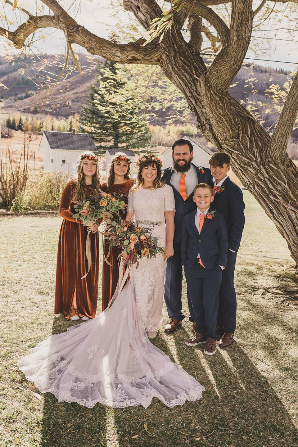 new family poses together after Utah elopement