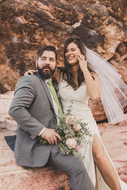 bride sits on groom's lap after eloping in Las Vegas