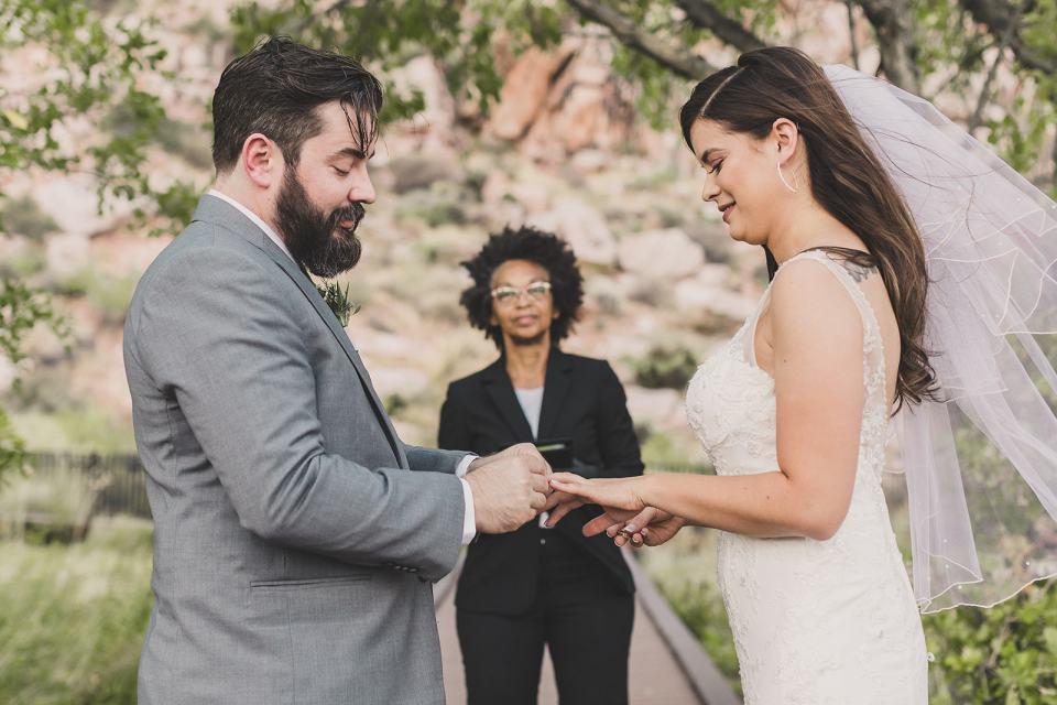 newlyweds exchange rings during Las Vegas elopement