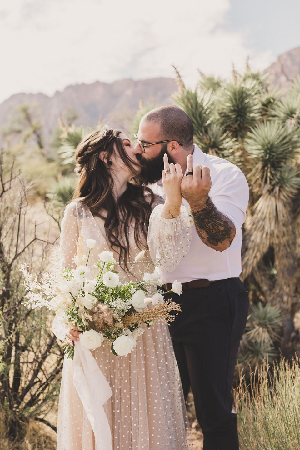 newlyweds show off wedding rings during Spring Mountain Ranch Elopement photos