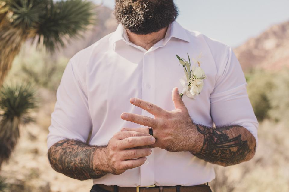 groom twists wedding ring during Las Vegas wedding photos