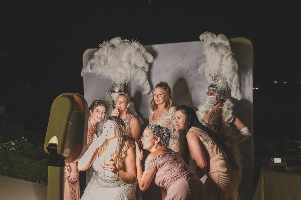 The Westin Lake Las Vegas wedding reception photo booth with show girls