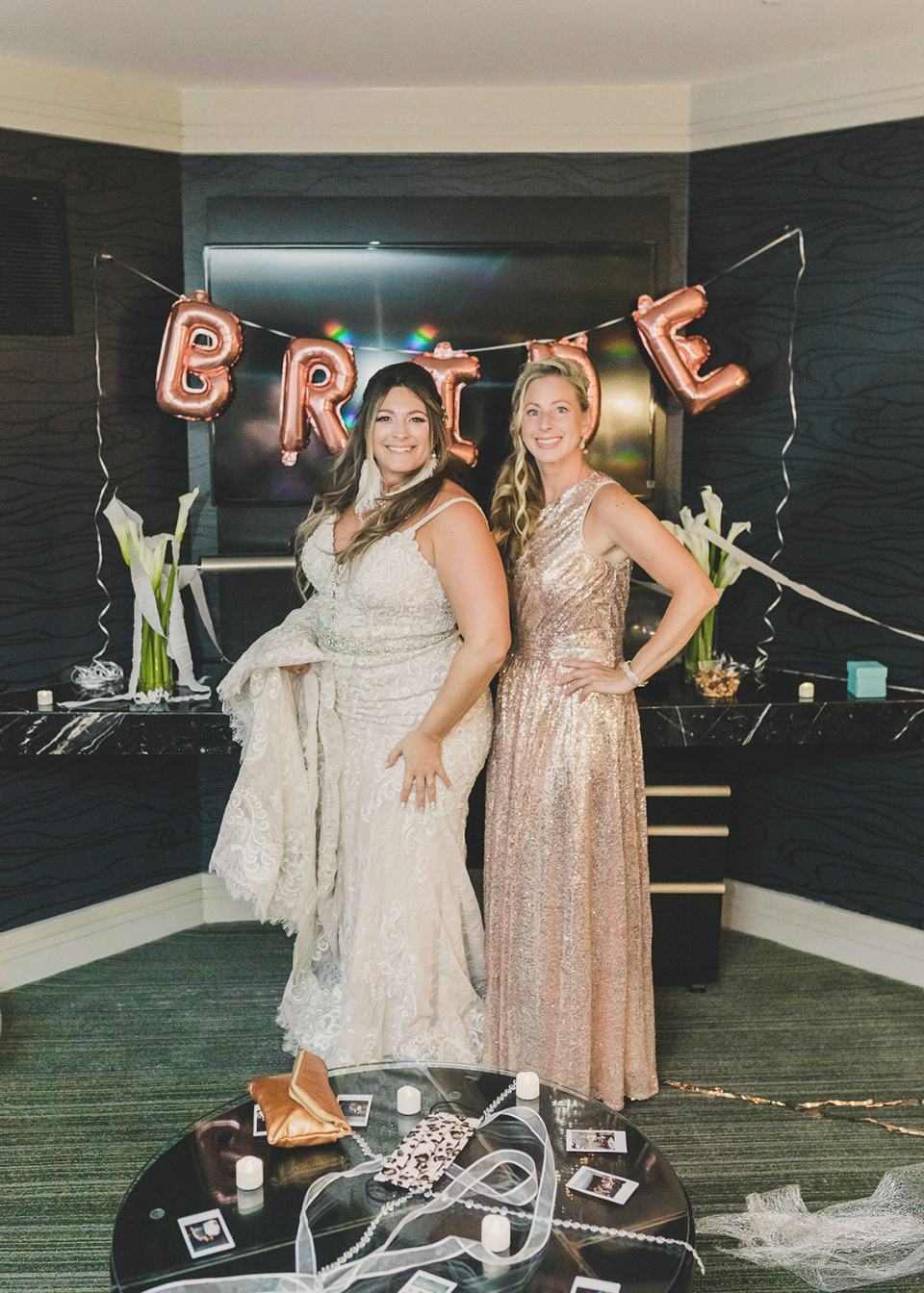 bride and sister pose by BRIDE balloons
