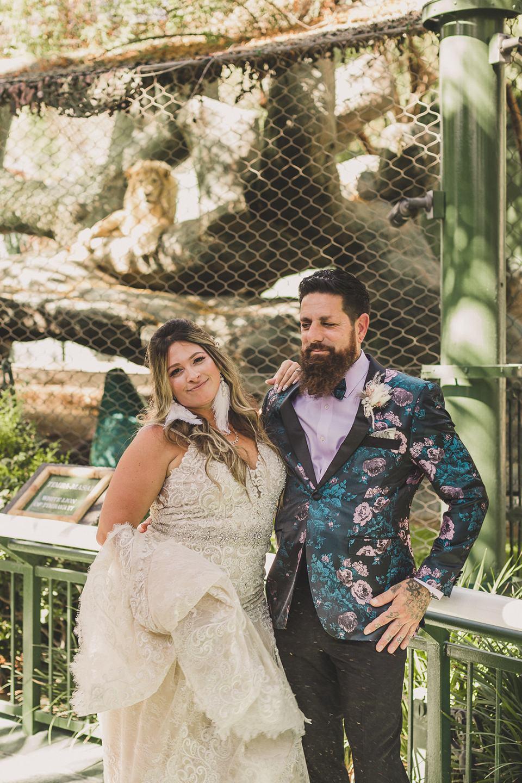 bride and groom pose before Las Vegas wedding