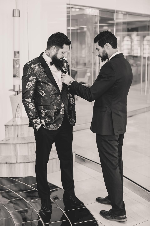 friend adjusts groom's tie before Westin Lake Las Vegas wedding