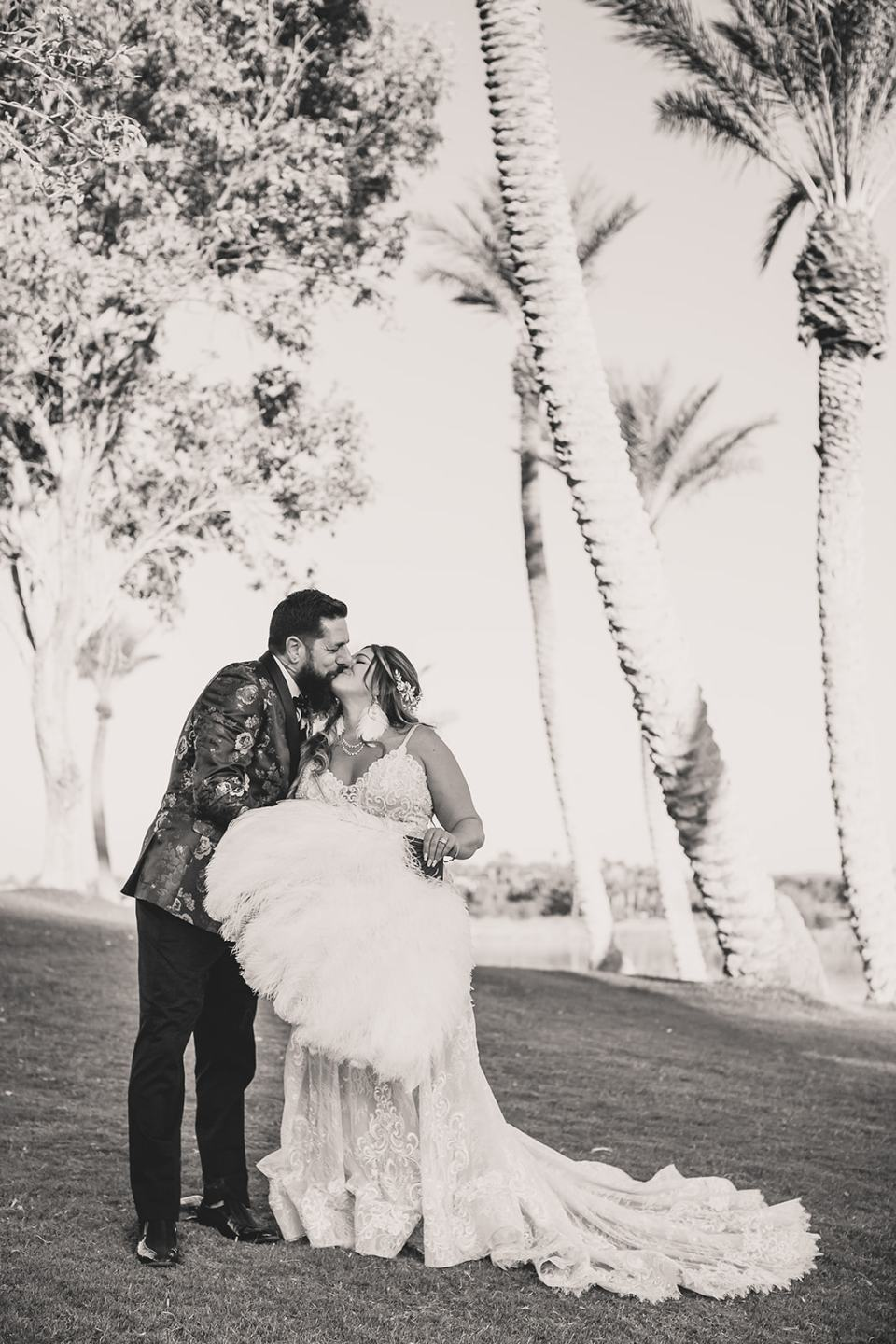 bride and groom kiss on hill in Las Vegas