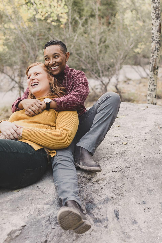 couple hugs on rocks in Mt Charleston